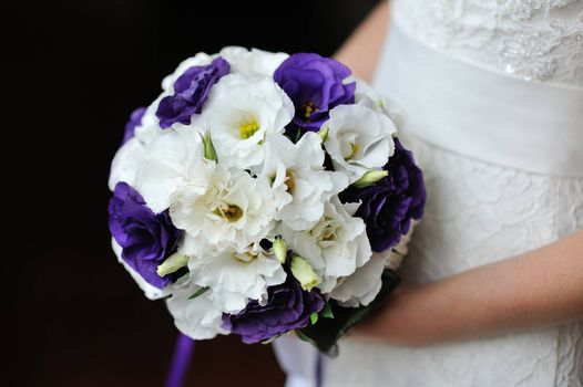 wedding bouquet of purple and white flowers