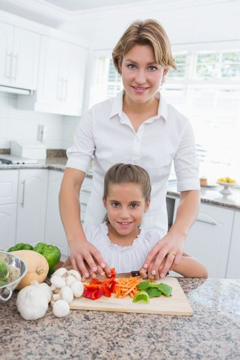 Mother and daughter preparing vegetables
