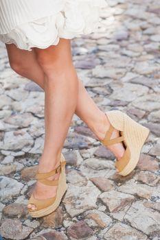 Womens legs in wedge heels