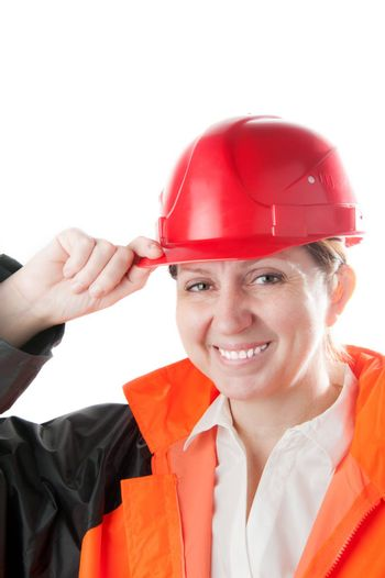Caucasian mature woman in a red helmet and workwear, isolated on a white background.