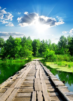 Sun over wooden bridge