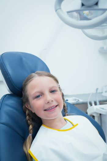 Portrait of smiling girl waiting for a dental exam