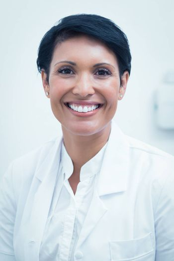 Portrait of a confident female dentist smiling