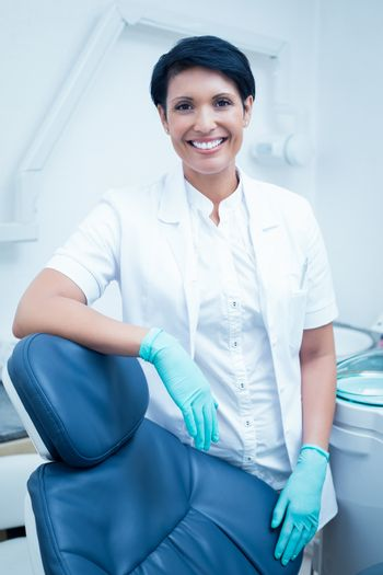 Portrait of happy confident female dentist