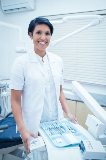 Portrait of smiling female dentist
