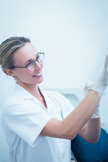 Portrait of female dentist wearing surgical glove