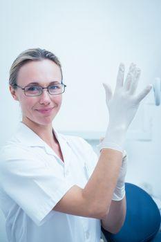Portrait of female dentist wearing surgical glove