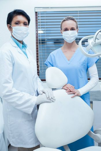 Portrait of two female dentists wearing surgical masks