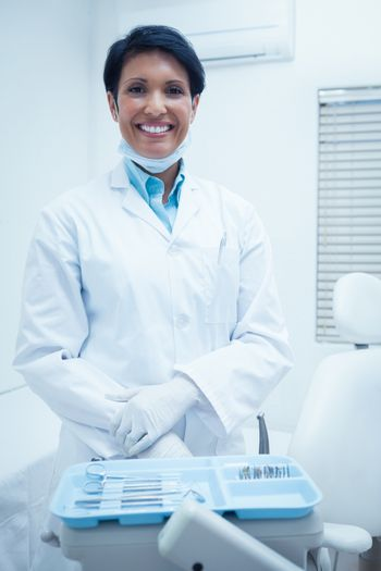 Portrait of smiling young female dentist