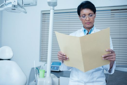 Dentist reading reports