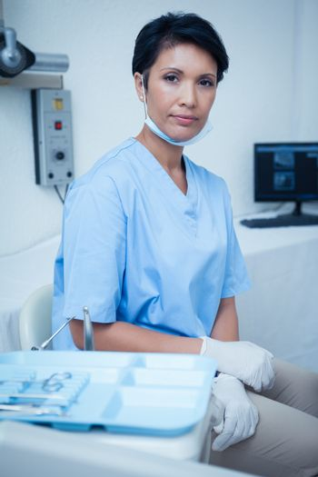 Portrait of confident young female dentist