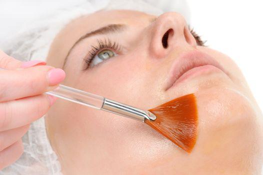 facial peeling mask applying