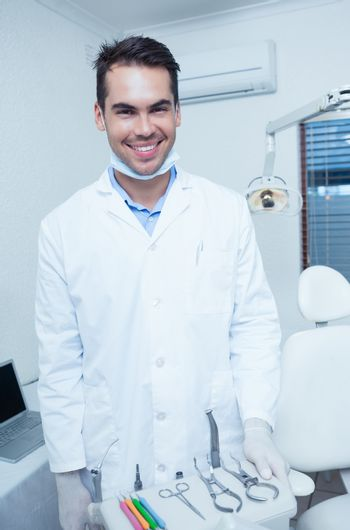Portrait of smiling young male dentist