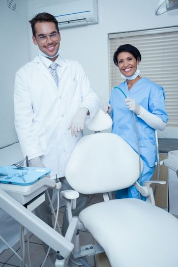 Portrait of smiling male and female dentists