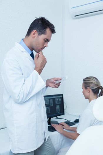 Male and female dentists at work