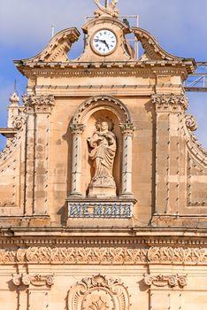 Facade of church on Gozo Island with Maria