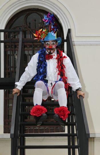SAO PAULO, BRAZIL - MARCH 8, 2015: An unidentified funny clown with typical costumes on the streets of Sao Paulo Brazil.