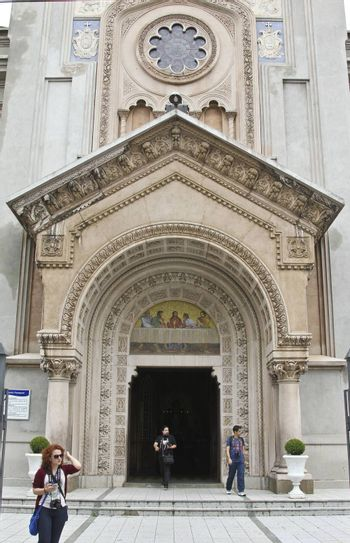 SAO PAULO, BRAZIL - MARCH 8, 2015: Door with details of the traditional stone art on bas relief on Nossa Senhora Auxiliadora Catholic Church in Sao Paulo Brazil.
