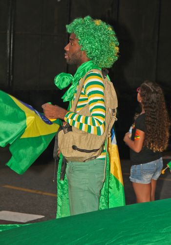 SAO PAULO, BRAZIL - APRIL 12, 2015: An unidentified man with green and yellow costume at protest against federal government corruption in Sao Paulo Brazil. Protesters call for the impeachment of President Dilma Rousseff.