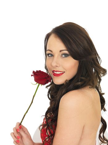 Sexy Young Woman Wearing Red Lingerie and Holding Red Valentines Roses