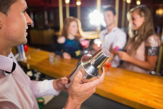 Bartender mixing up a cocktail