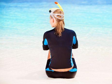 Calm diver girl on seashore