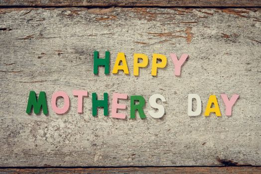 "The words ""HAPPY MOTHERS DAY"" on old wooden plank."
