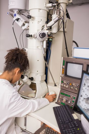 Biochemistry students using large microscope and computer