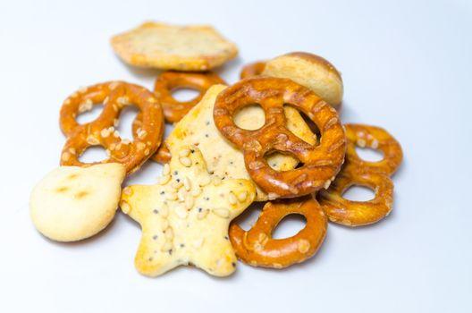 Salt pastries, snacks against white background.