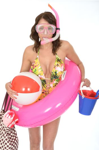 Young Woman Wearing a Swim Suit on Holiday Wearinmg a Snorkel and Rubber Ring