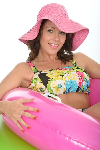 Attractive Young Woman Sitting in Rubber Rings Wearing a Swimsuit