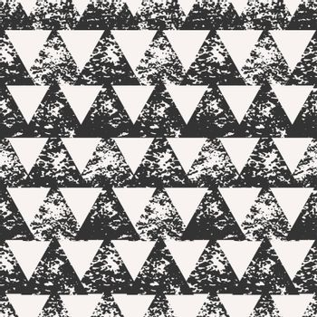 Abstract seamless pattern with stamped triangles. Hand drawn watercolor geometric pattern.