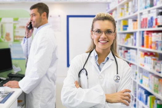 Pharmacist smiling with Pharmacist on the phone