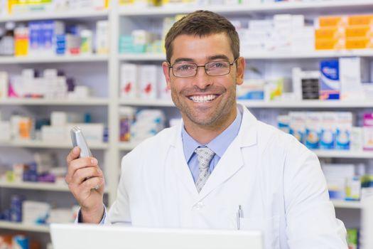 Happy pharmacist on the phone