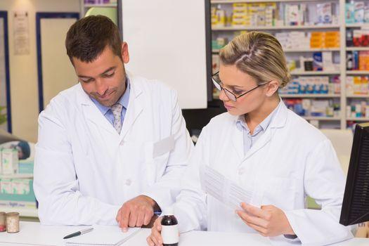 Pharmacists showing a prescription