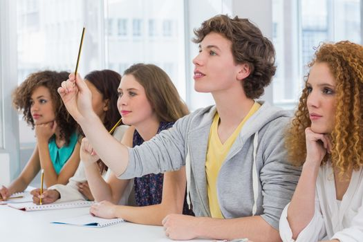 Fashion students being attentive in class at the college