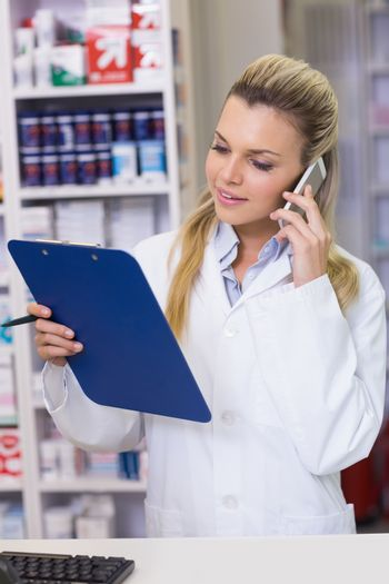 Young pharmacist on the phone