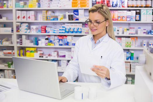Pharmacist using the computer