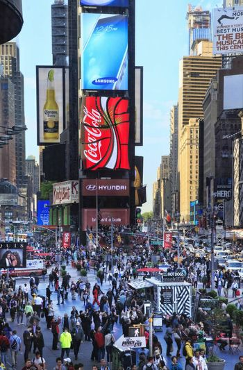 New York, NY, USA - May 16, 2013: Times Square, featured with Broadway Theaters and huge number of LED signs, is a symbol of New York City and the United States, May 16, 2013 in Manhattan, New York City