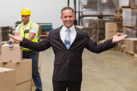 Smiling boss with hands out
