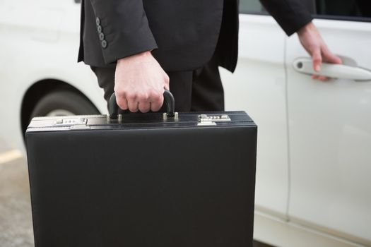 Close up of businessman holding a car door handles