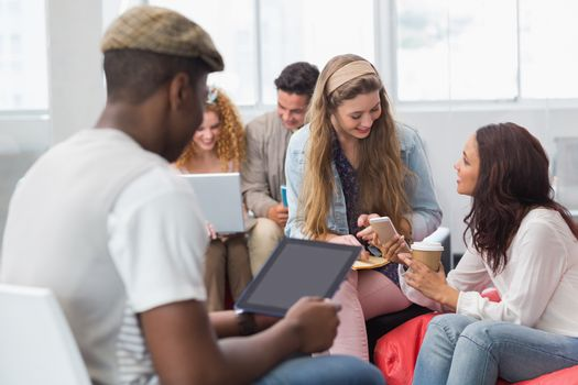 Fashion students chatting and smiling at the college