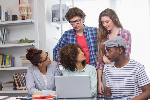 Fashion students working as a team  at the college