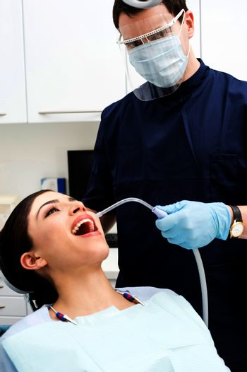 Female patient with dentist in a dental treatment