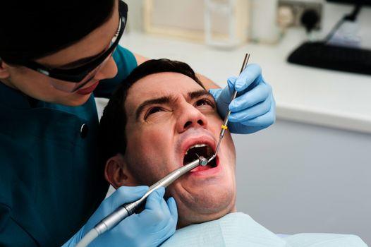 Dentist treat a man teeth