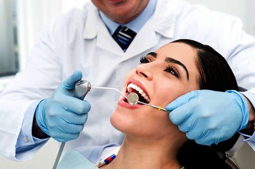 Ddental treatment of female.
