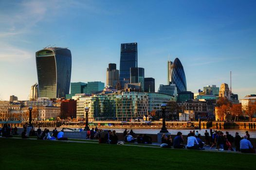 LONDON - APRIL 14: Financial district of the City of London on April 14, 2015 in London, UK. The City has a resident population of about 7,000 but over 300,000 people commute to and work there.