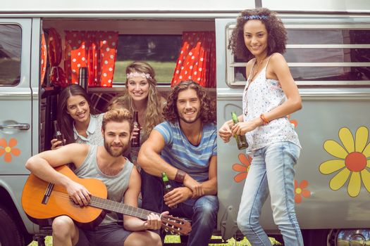 Hipster friends in a camper van