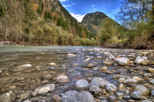 Rocks in the flowing river at the mountains