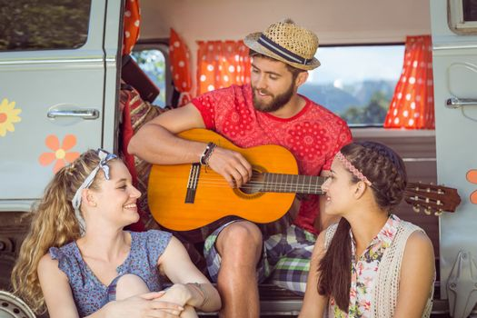 Hipster friends by their camper van